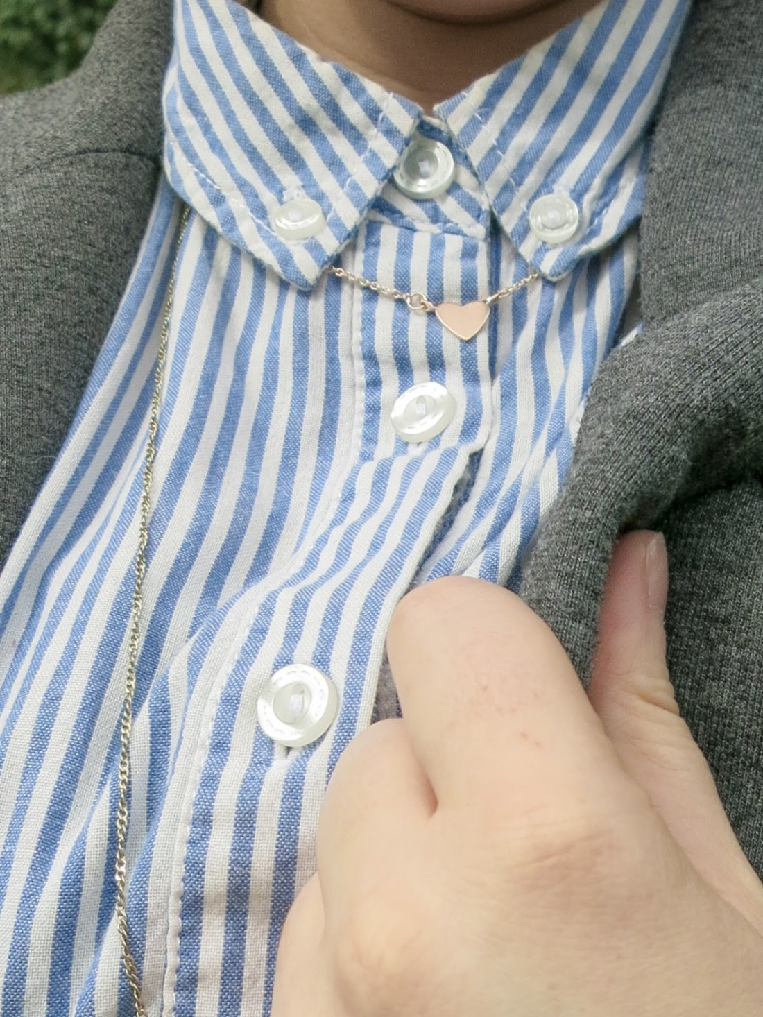 extreme close up of the shirt collar, also showing my necklaces.