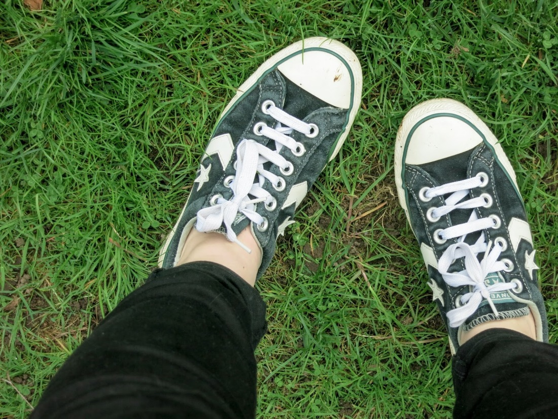close up of black, low-top Converse