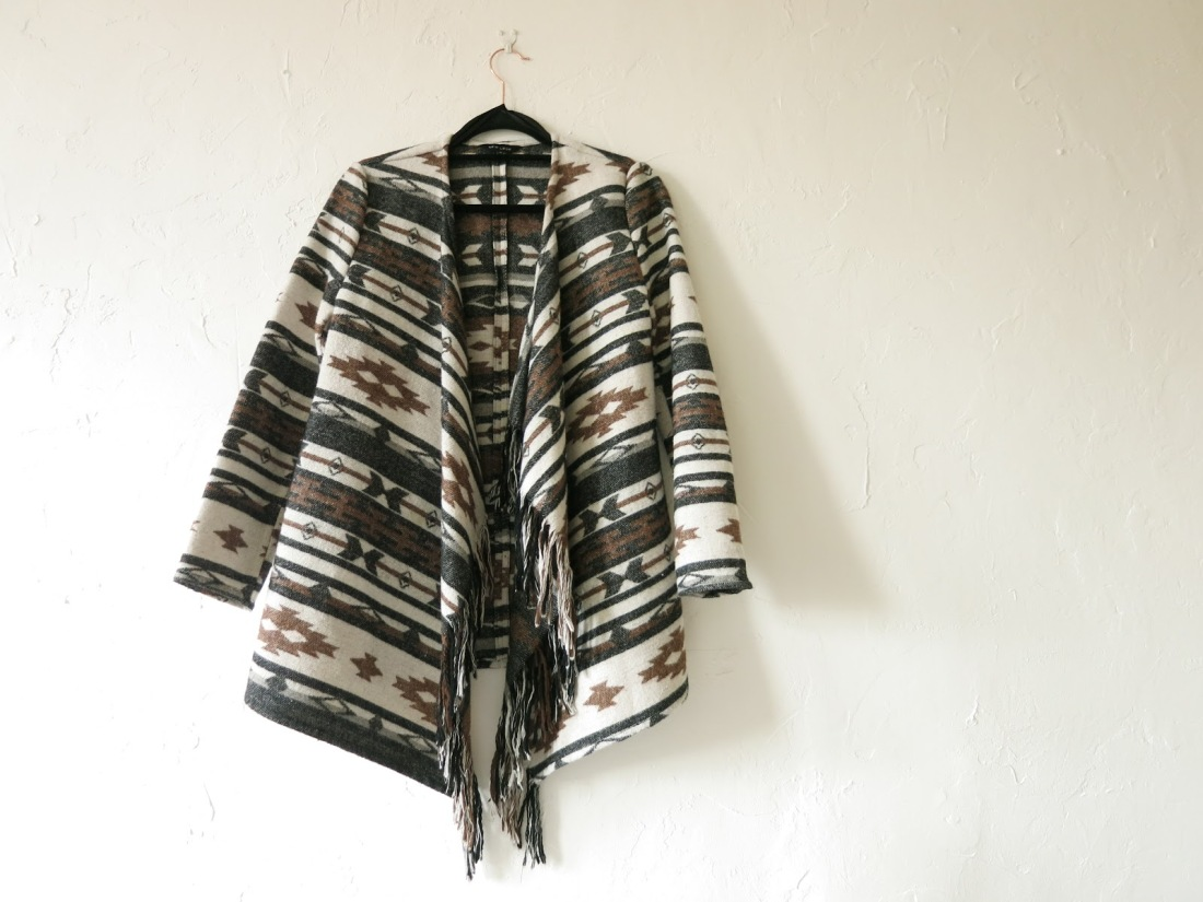 neutral coloured waterfall cardigan with tassell details