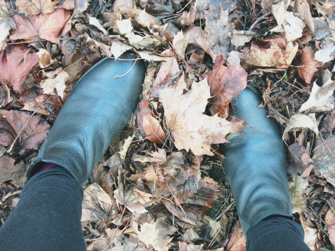 black boots and autumnal leaves