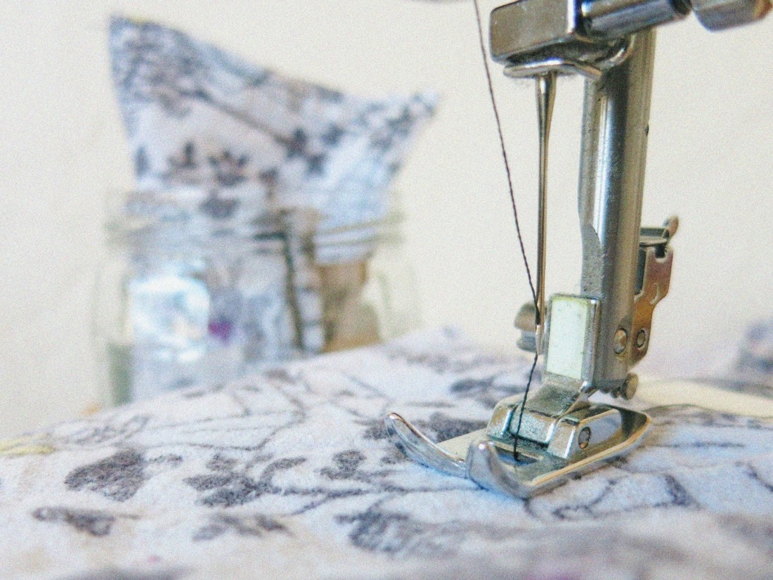 close up shot of the foot of my sewing machine, with fabric in the background.