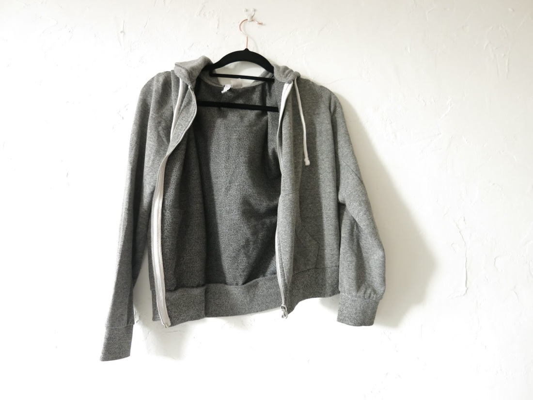 grey zip-up sweatshirt