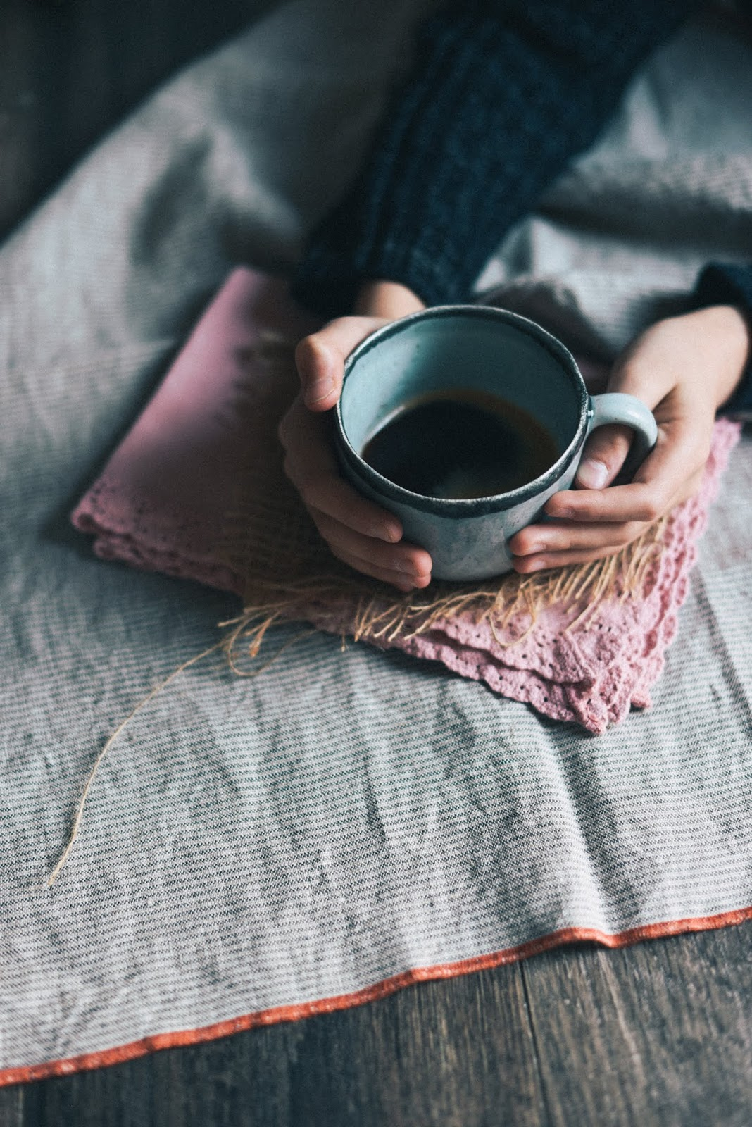 person holding coffee cup - anxiety depression mornings are hard