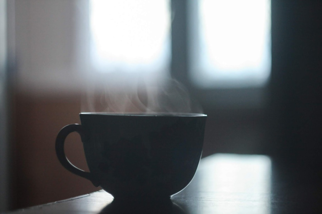 dark silhouette of a cup of coffee - waking up morning mental health issues anxiety depression